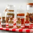 Spices in glass bottles — Stock Photo #72162371