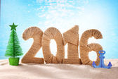 New year 2016 sign on beach — Stock Photo