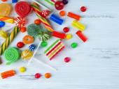 Colorful candies on wooden background — Stock Photo