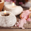 Candles and sea salt on table close up — Stock Photo #72191119