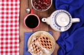 Baking, tea and jam on wooden table top view — 图库照片
