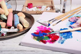Professional art materials on color wooden background — Stock Photo