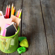 Colorful pencils with paper notes in metal stand on wooden table background — Stock Photo #72477923