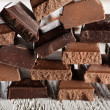 Pyramid of squared chocolate on wooden table — Stock Photo #72478195
