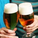 Beer in female hands, closeup — Stock Photo #72478491