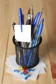Pens in metal holder on wooden table background — Stock Photo