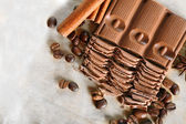 Chopped chocolate on parchment, top view — Stock Photo