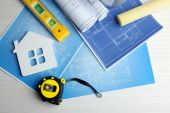 Construction instruments, plan and brushes — Stock Photo