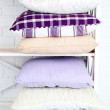 Decorative pillows on shelf — Stock Photo #72711335