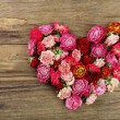 Heart of beautiful dry flowers on wooden background — Stock Photo #72712751