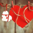 Bright hearts hanging on rope on wooden background — Stock Photo #72714559