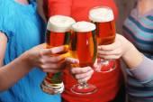 Beer in female hands — Stock Photo