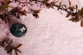 Spa stones and spring flowers on towel background — Stock Photo