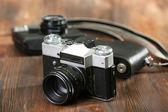 Retro camera on table close-up — Stock Photo