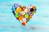 Sewing buttons heart on wooden background — Fotografia Stock