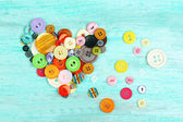 Sewing buttons heart on wooden background — Foto de Stock