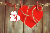 Bright hearts hanging on rope on wooden background — Foto de Stock
