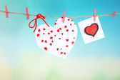 Hearts hanging on rope on bright background — Foto de Stock