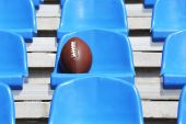 Rugby ball on stadium seat — Stock Photo