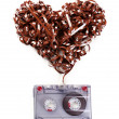 Audio cassette with magnetic tape in shape of heart isolated on white — Stock Photo #72758845