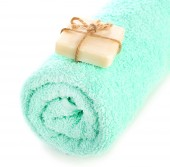 Rolled terry towel with soap isolated on white — Stock Photo