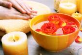 Female hands with bowl of aroma spa water — Stock Photo