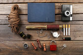 Hiking gear on wooden background — Stock Photo
