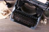Retro typewriter on wooden table, top view — Stok fotoğraf