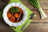 Mushroom soup on wooden table, top view — Stock Photo