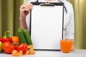 Nutritionist doctor with clipboard for diet plan in office — Foto de Stock