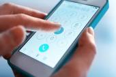 Finger touch number on smartphone — Stock Photo