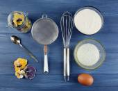 Making candied violet flowers with egg whites and sugar, on color wooden background — Stock Photo