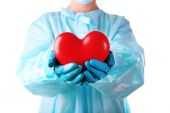 Decorative heart in doctors hands, isolated on white — Fotografia Stock