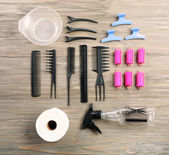 Hairdressing tools on wooden background — Foto de Stock