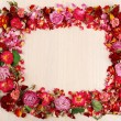 Frame of beautiful dry flowers on wooden background — Stock Photo #72908365