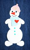 Handmade snowman on dark jeans background — Stock Photo