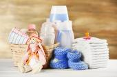 Baby accessories on table on grey background — Stock Photo