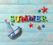 Word summer on wooden background — Stock Photo