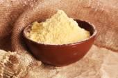 Bowl of whole flour on burlap cloth, closeup — Stock Photo