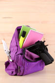 Gun in school backpack on wooden background — Stock Photo