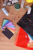 Samples of colorful fabric on wooden table, top view — Stock Photo