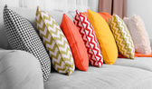 Sofa with colorful pillows in room — Stock Photo