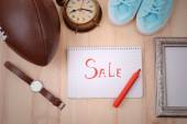 Sale unwanted stuff on wooden background top view — Stock Photo