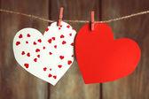 Bright hearts hanging on rope — ストック写真