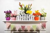 Beautiful flowers in ornamental flowerpot — Stock Photo