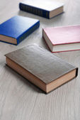 Heap of books on wooden background — Stock Photo