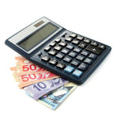 Calculator and Canadian dollars — 图库照片