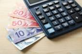 Calculator and Canadian dollars — Stock Photo