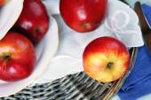 Tasty ripe apples on table close up — Stock Photo