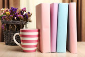 Books, cup and plant — Stock Photo